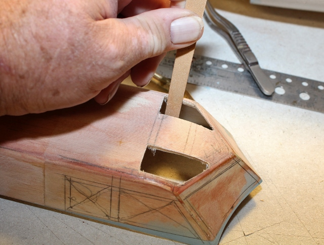 B-17-16-2    An emery board is the best tool I have found for tight, precise sanding jobs like this.