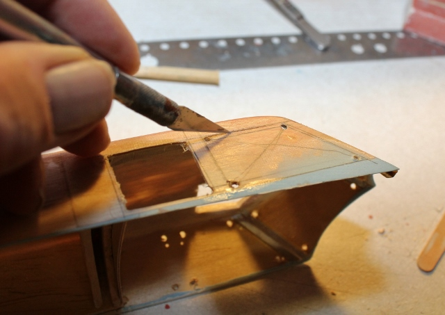 B-17-16-4     and VERY CAREFULLY cut out the window openings. While you weren't looking I did some more careful sanding of those window frames edges and…