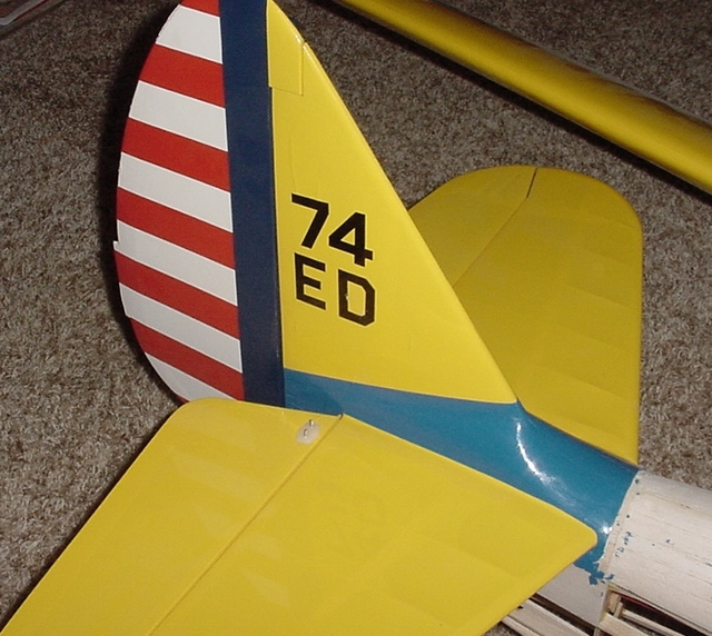 PT-19-5    Same game with the tail assembly. The shape of the vertical fin fairing is all WRONG and the horizontal tail is plastic covered open (ribbed) structure. It's supposed to represent the plywood skinned surface on the full scale PT-19.